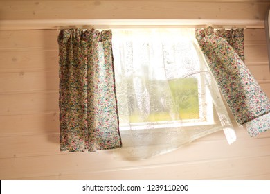 Open window. The wind blows curtains. Summer.