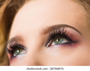 open woman eyes with long eyelashes