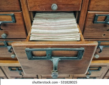 Open wooden boxes with index cards in library, Selective focus and Close up image
