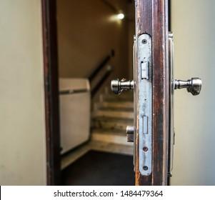 Open wooden door close-up. Mortise lock in the door.