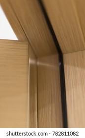 Open wooden door. Fragment of the open door. Geometric abstraction