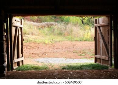 Open wooden gate old village barn