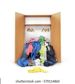 Open wooden wardrobe. Clothing falls from the open cabinet isolated on the whitebackground