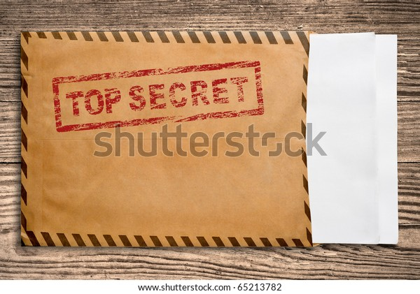 Open yellow envelope with top secret stamp and blank papers, on wooden table, clipping path.