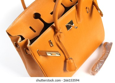 Open yellow genuine leather bag isolated on white background