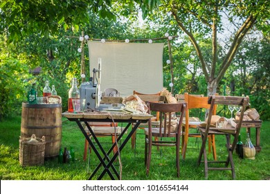 Open-air cinema with retro projector in the evening