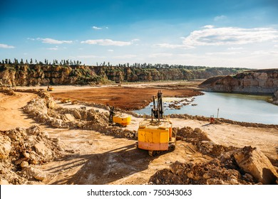 Opencast mining quarry with machinery at work. Digging equipment, industrial landscape