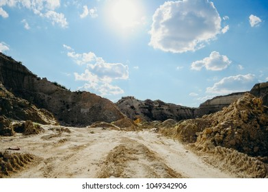 Opencast mining quarry. This area has been mined for sand and other minerals. Restoration of a part of the mined glass sand quarry. Dunes of the sand quarry. Landscapes and Nature