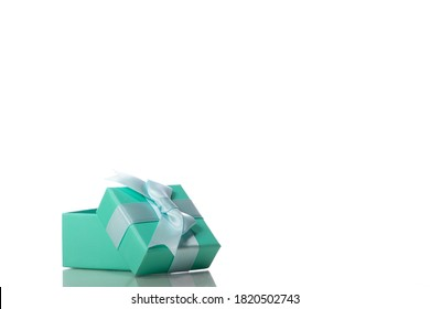 Opened beautiful mint colour gift box with bow isolated on white background. Presents, surprise, holiday congratulations, store promotion, marketing raffle prizes, greeting banner concept. Copy space