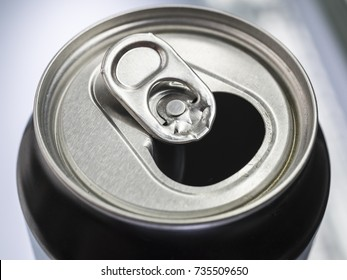 Opened beverage can with stay-tab mechanism.