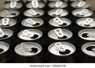 opened black canned beers