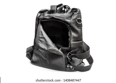 Opened black leather backpack on white background.