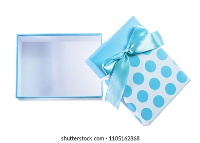 Opened blue gift box with ribbon isolated on white.