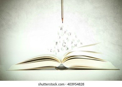 opened book with alphabet letter flying out of pages, vintage color tone