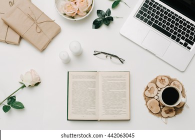 Opened book with glasses and coffee. White background. Education concept