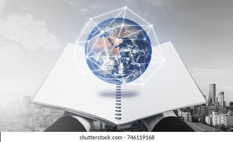 Opened book with globe hologram. Education, knowledge technology and e-learning concept. Elements of this image are furnished by NASA