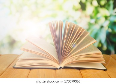 Opened book on bright background