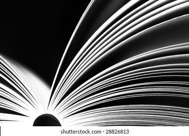 Opened book on dark background - black and white version