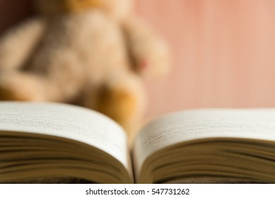 opened book on table with blur background