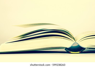 the opened book on white background