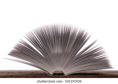 Opened book, pages fanning out