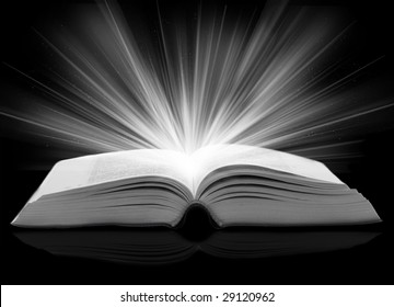 opened book with rays of light