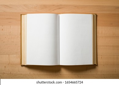 Opened book with white sheets