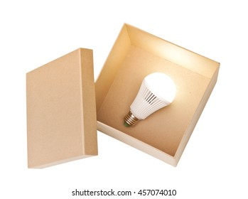 Opened brown paper box with switched on LED light bulb inside / New idea concept
