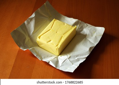 Opened butter package on table. Butter prices are at a record high.Cooking concept.