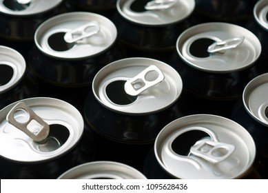 opened canned drinks in black