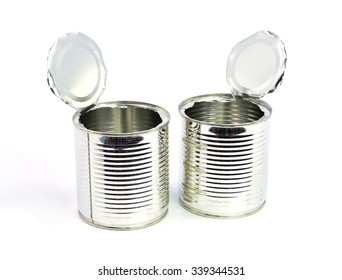 opened cans on white background