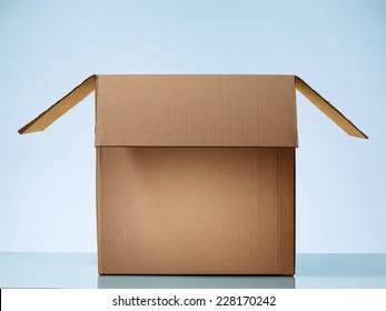 Opened cardboard box on beautiful light Blue Background