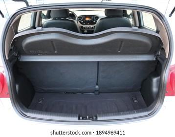 Opened clean modern car trunk.