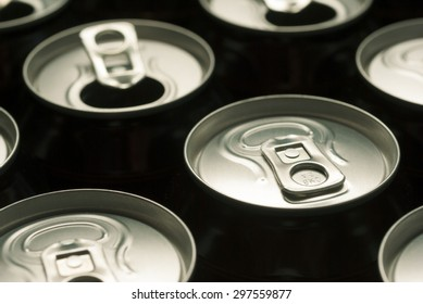 opened and closed canned drinks in black