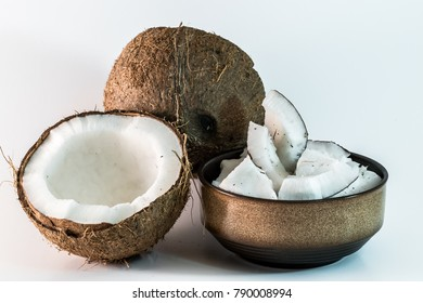 opened coconut with pieces to eat