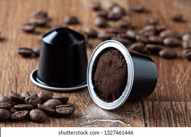 opened coffee pod on wooden table or capsula de cafe