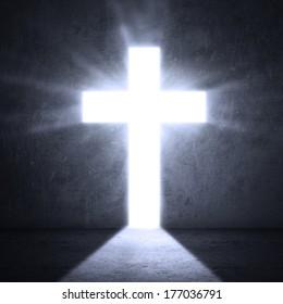 Opened door with bright light cross
