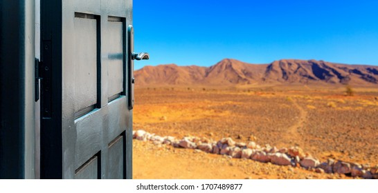 Opened door concept with a arid desert landscape in the background