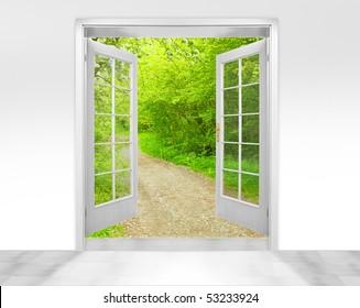 Opened door to early morning in green garden - conceptual image - environmental business metaphor.