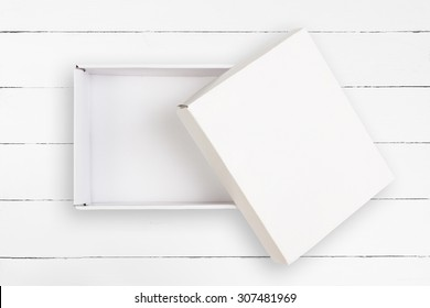 Opened empty cardboard box with cover on white background