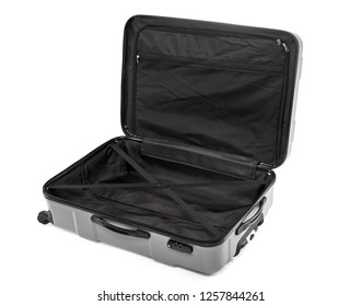 Opened empty large traveler suitcase isolated on white background