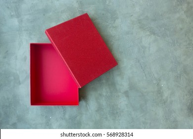 Opened & Empty Red Glitter Gift Box on Cement Background Texture Top View