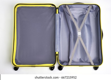 Opened empty traveler suitcase. Large bag for travelling, white background.