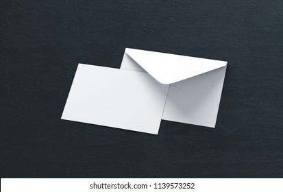 Opened envelope with blank card. Blank envelope with post card on dark background.