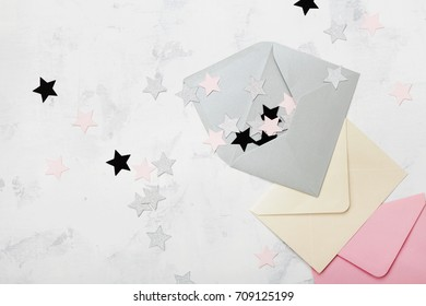 Opened envelope with colorful stars decoration top view. Mail and correspondence concept. Flat lay.