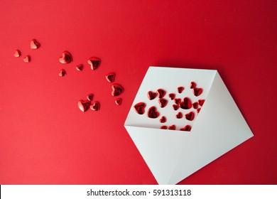 Opened envelope and many felt hearts