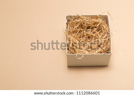 Opened gift box with decorative fillers