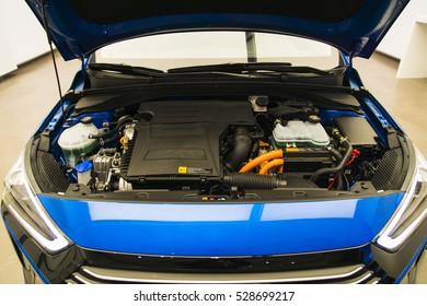 opened hood a blue car. engine room