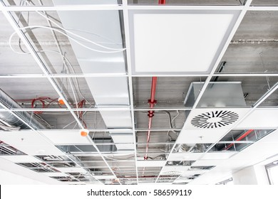 Opened hung ceiling at construction site