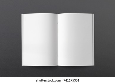Opened Magazine or Brochure on black paper. Blank pages top view. Mockup template for your showcase.